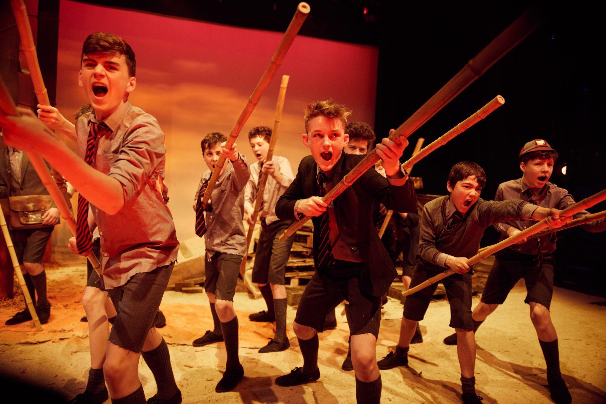 Pupils perform drama on stage at Magdalen College School.