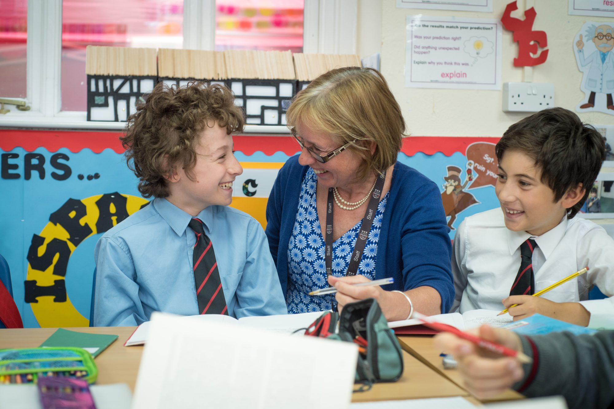 Magdalen College Junior School pupils learning in classroom with teacher