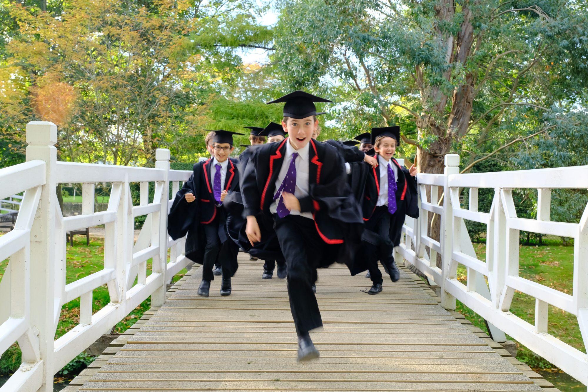 Magdalen College School pupils running over white bridges in Chorister uniform