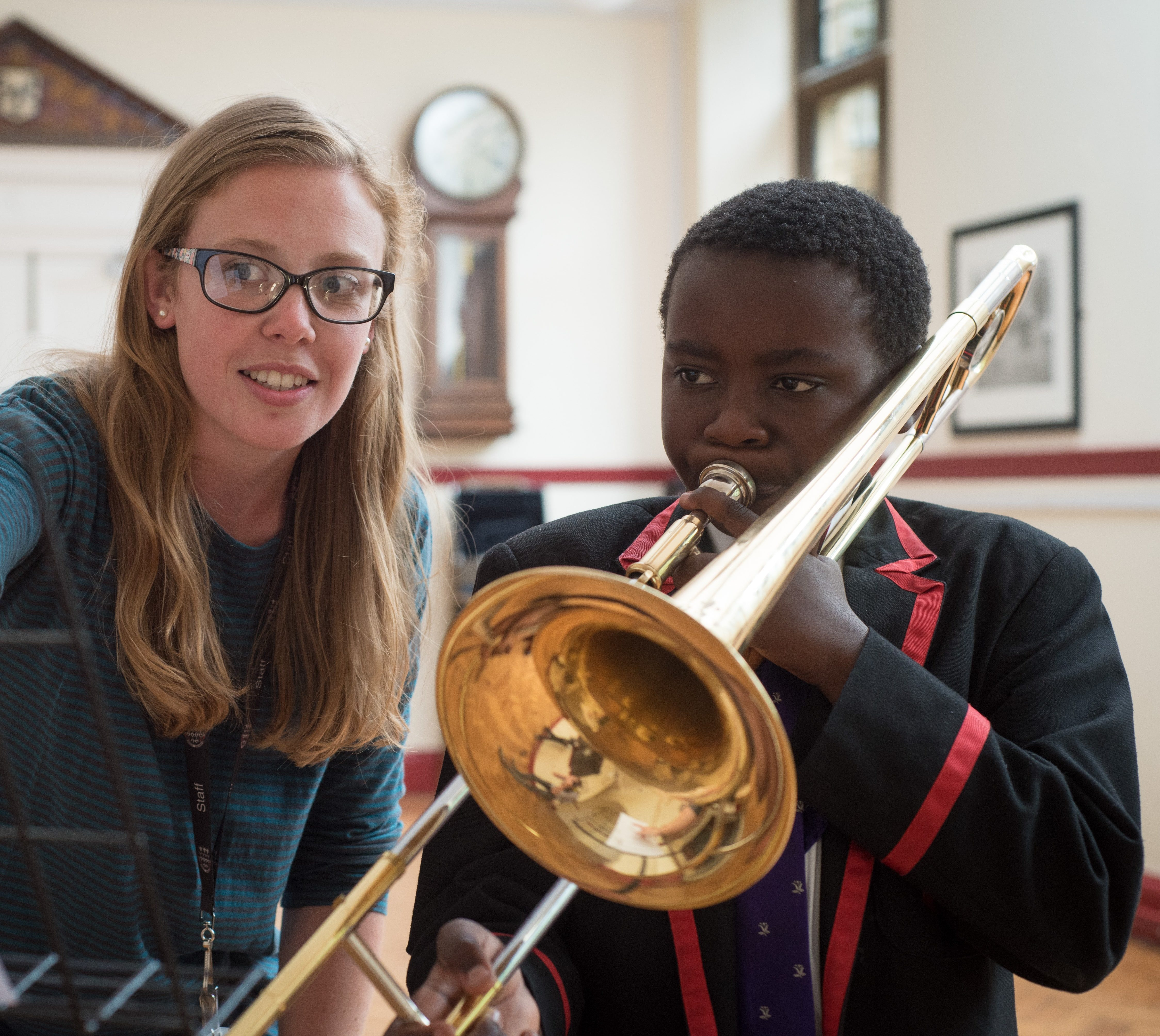 Magdalen College School pupil learning to play the trombone