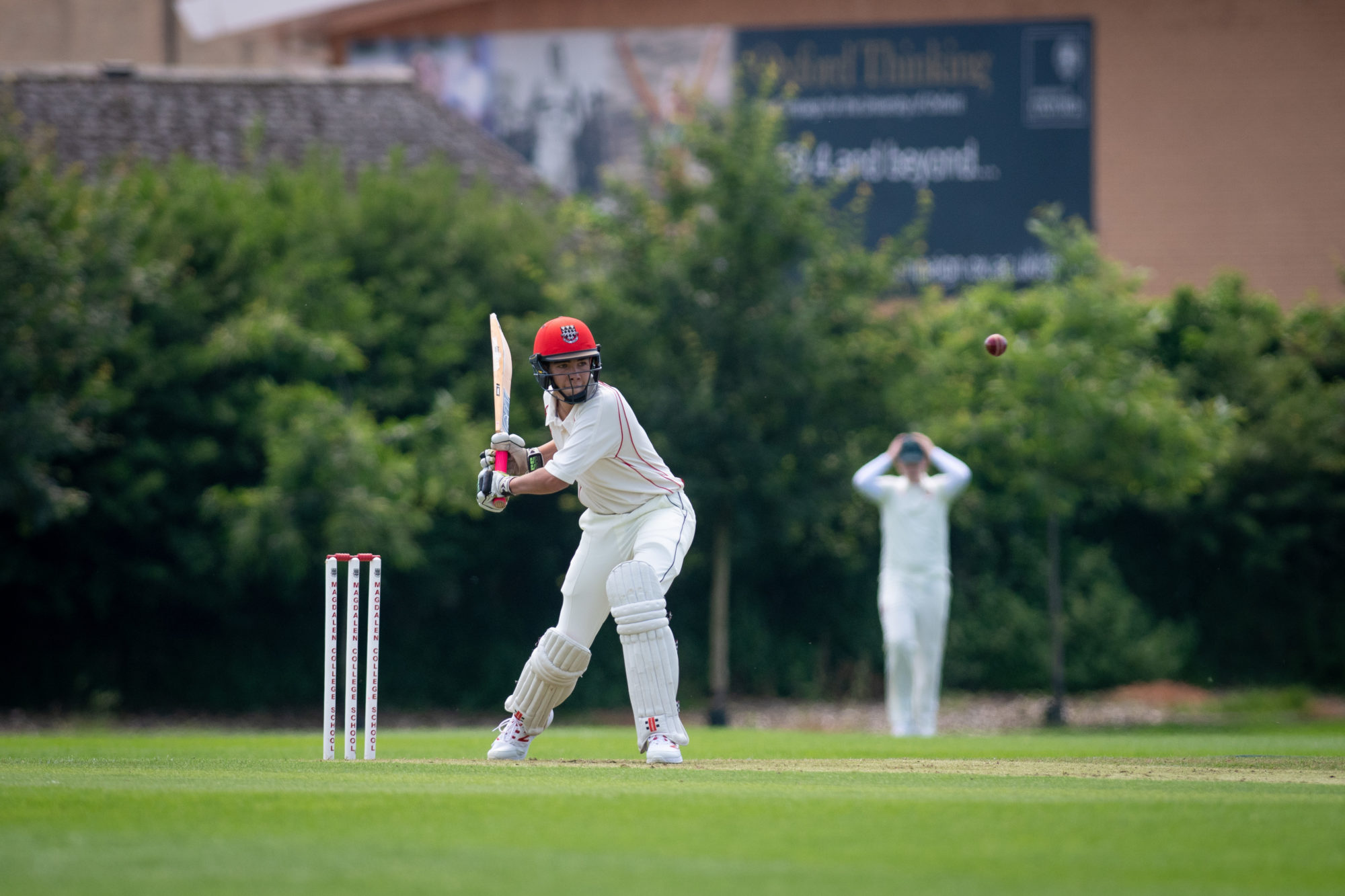Magdalen College School pupil playing cricket