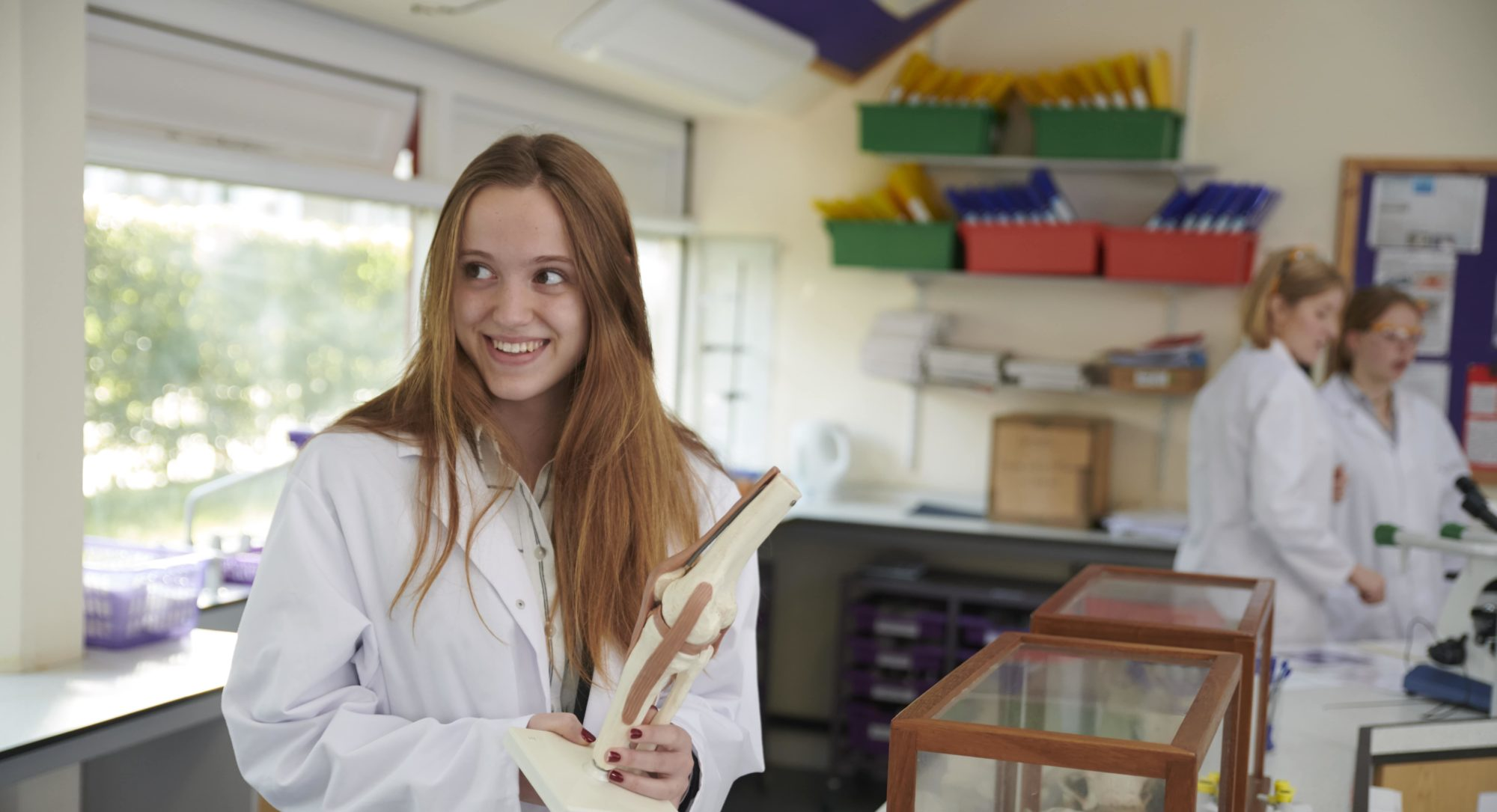 Magdalen College School pupil in lab coat studying science