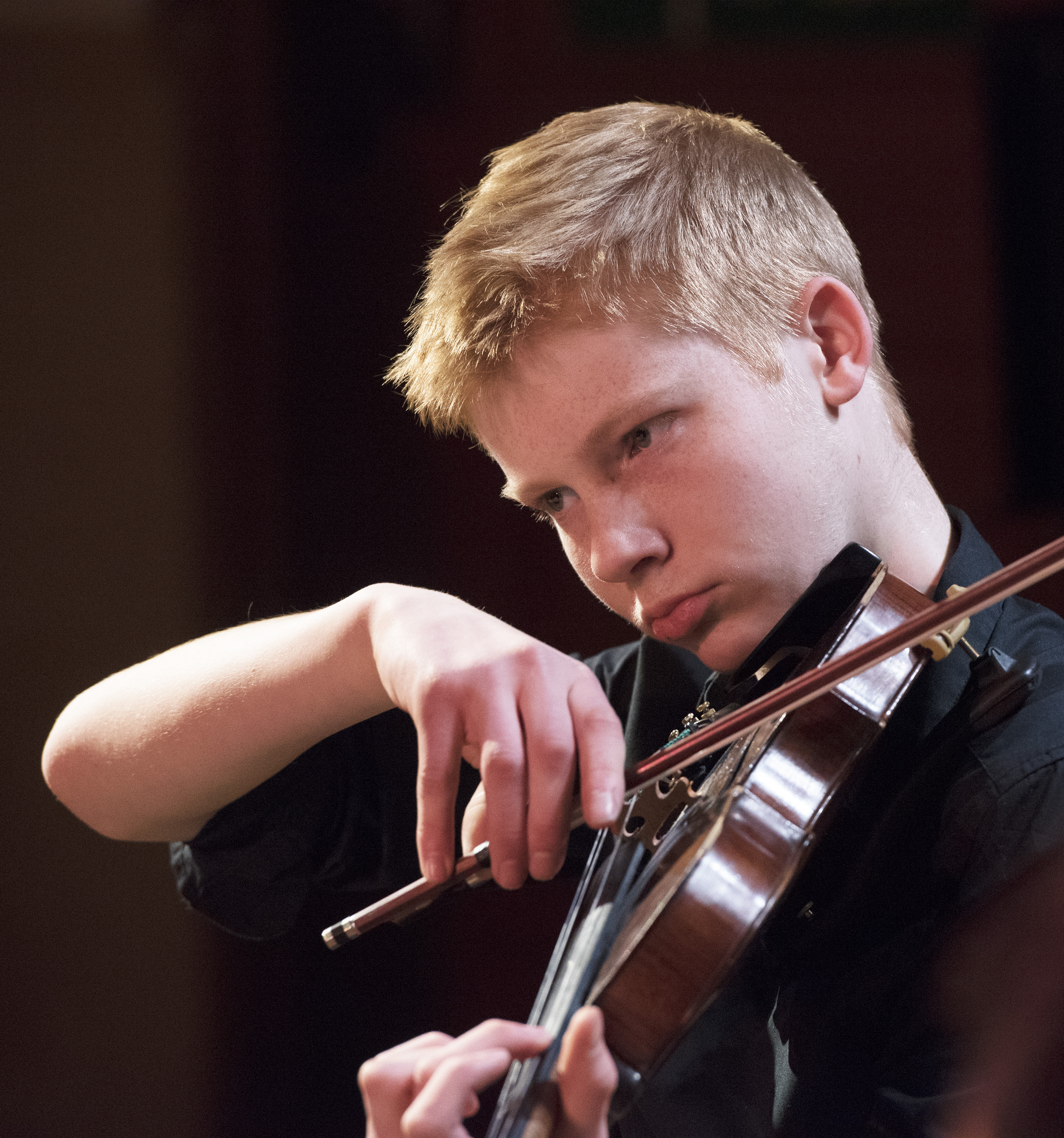 Magdalen College School pupil playing violin during instrumental lesson