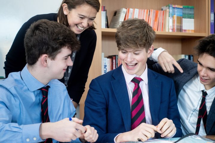 Magdalen College School Sixth Form pupils having discussion in Economics lesson