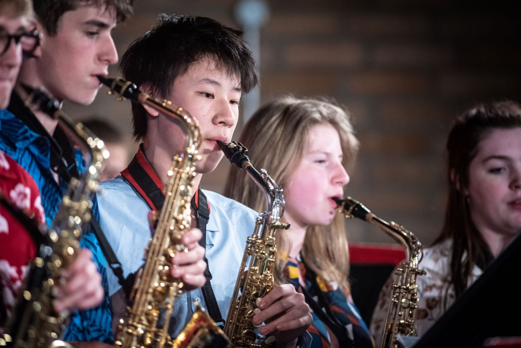 Magdalen College School Sixth Form Music pupils playing brass instruments