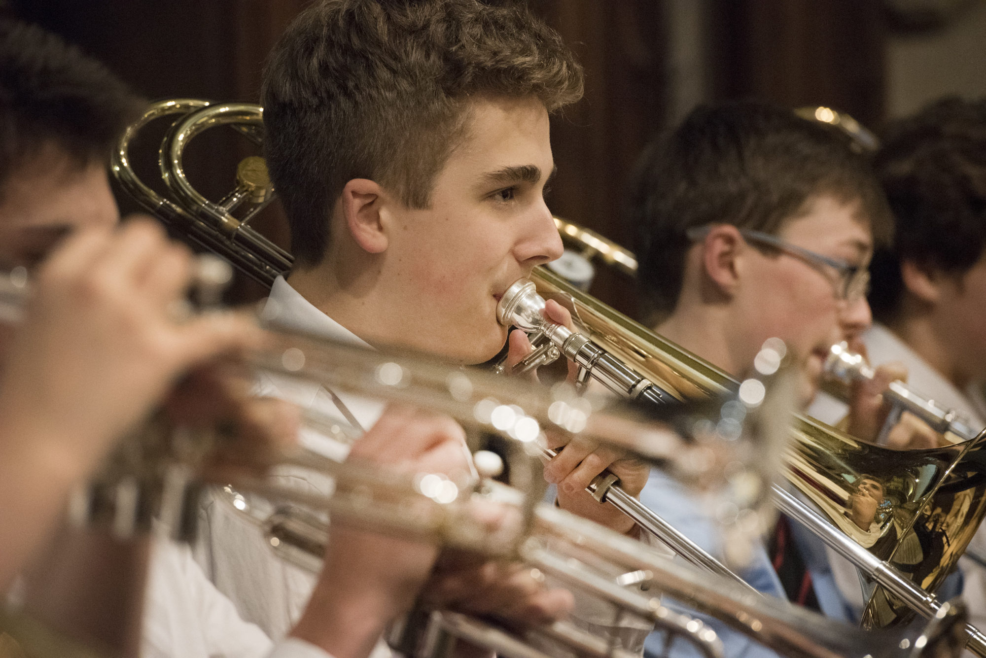 Magdalen College School pupils playing brass instruments