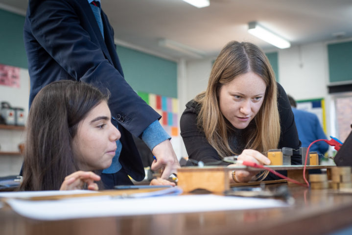 Girls study Physics in classroom at Magdalen College School