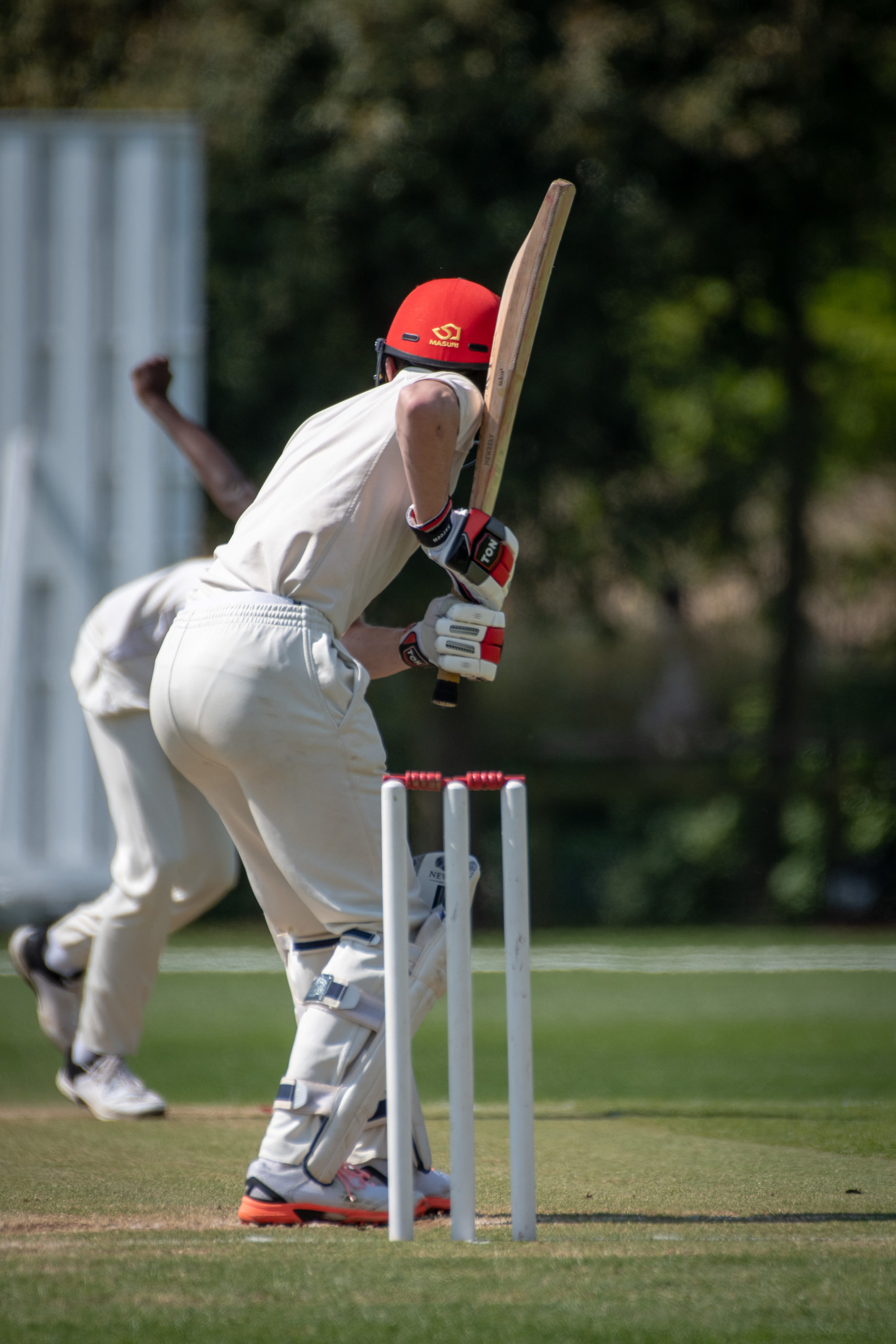 Magdalen College School Sixth Form pupil playing cricket