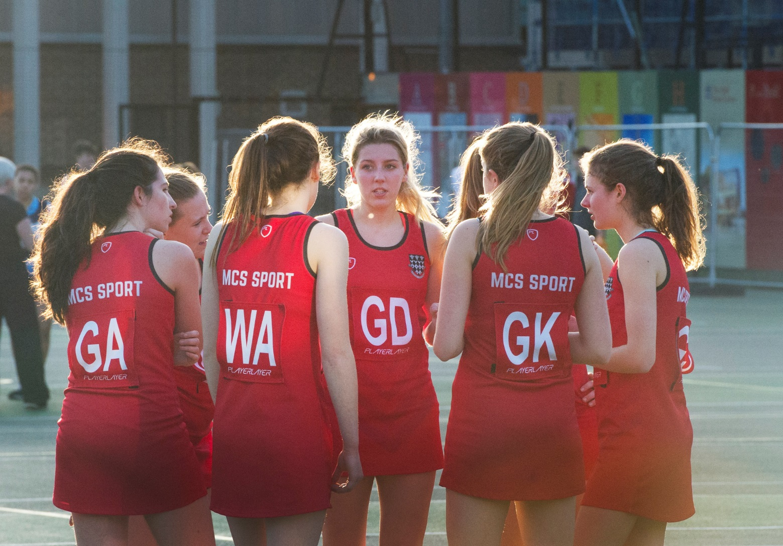 Magdalen College School Sixth Form pupils playing netball