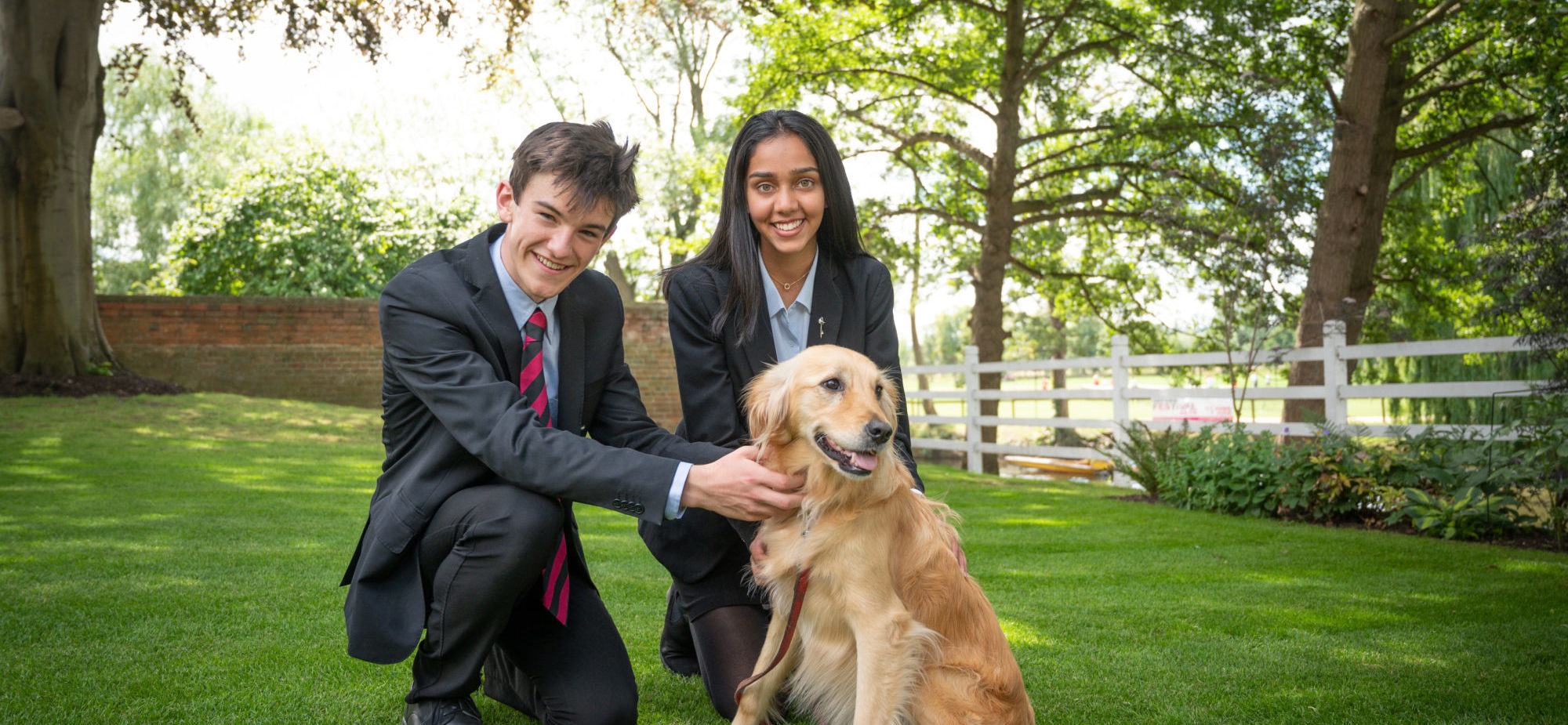 Magdalen College School Sixth Form pupils with the Master's dog