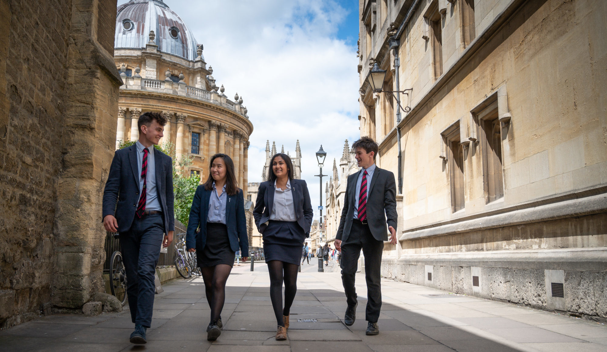 Magdalen College School Sixth Form students walking through Oxford in uniform