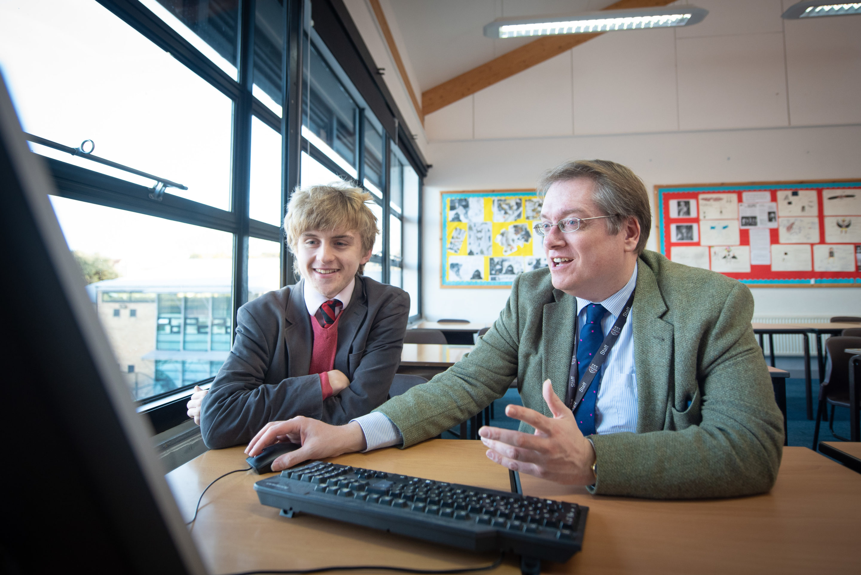 Peter Macdonald, Magdalen College School Director of Higher Education, advises pupil on university entrance.