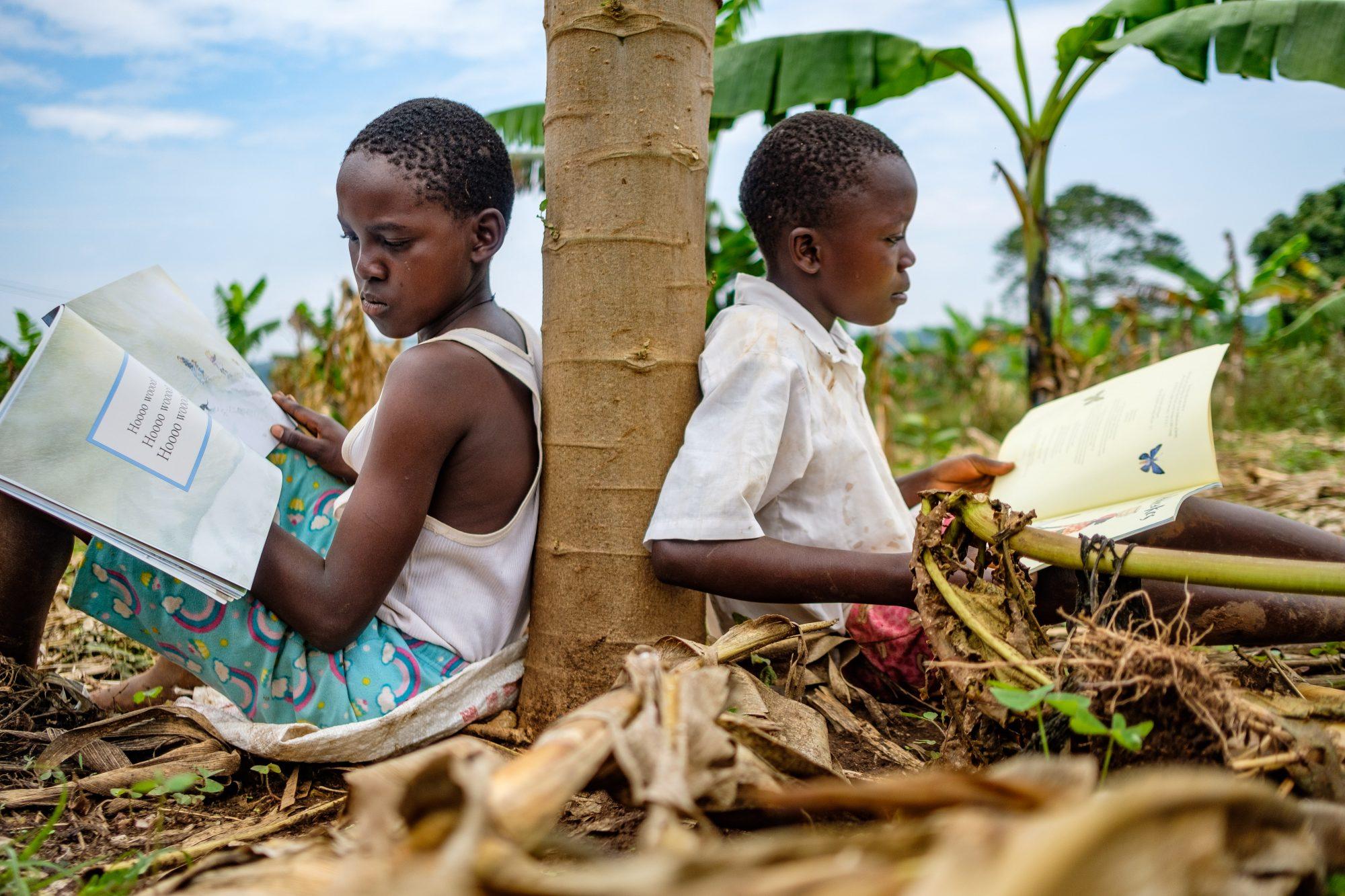 Pupils from Mustardseed School, Sentema Uganda sitting under tree