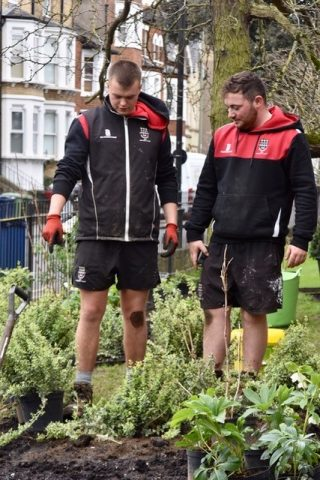 Magdalen College School Grounds Team working on garden next to Big School