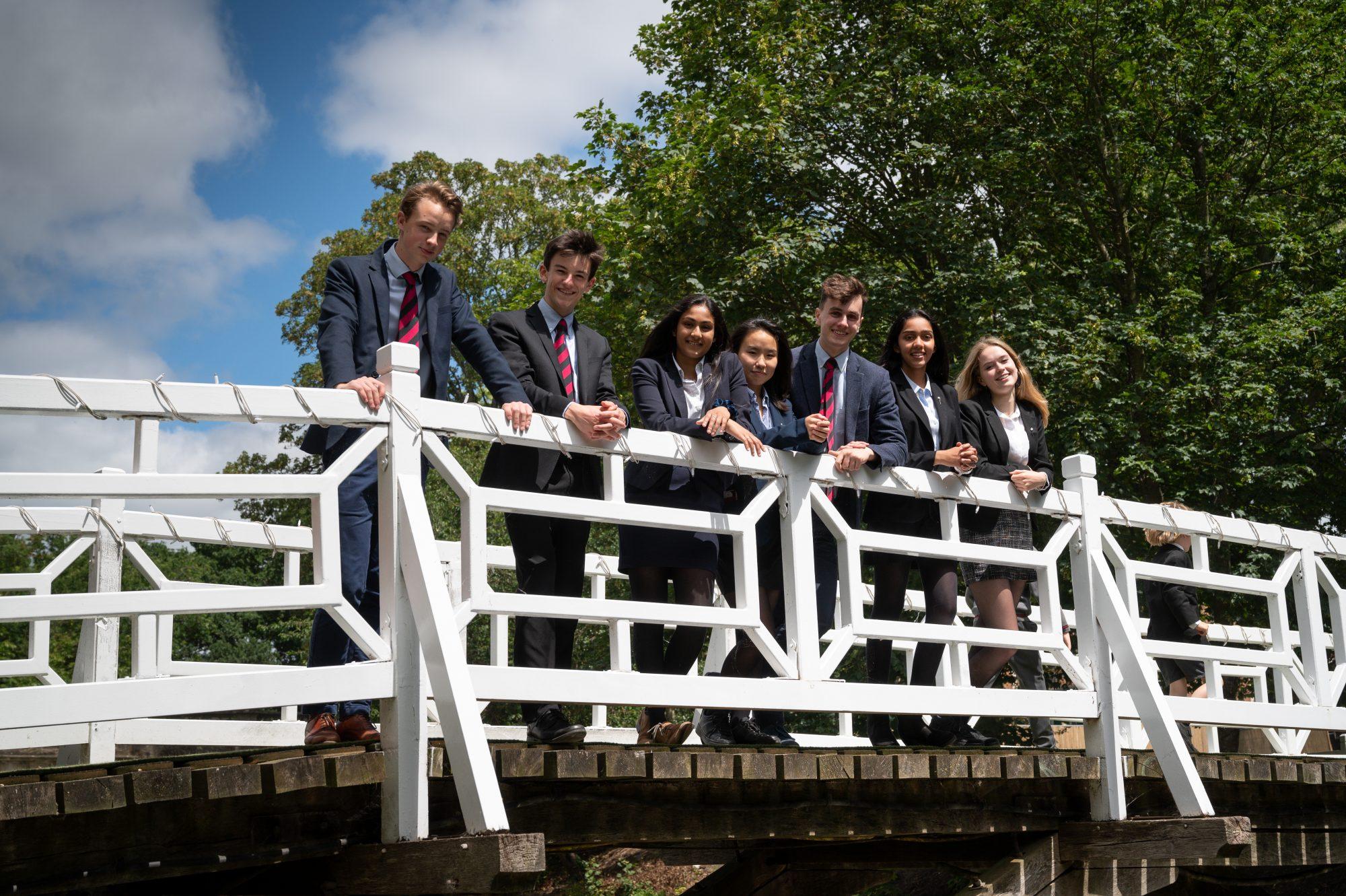 Magdalen College School Sixth Form pupils on white bridge