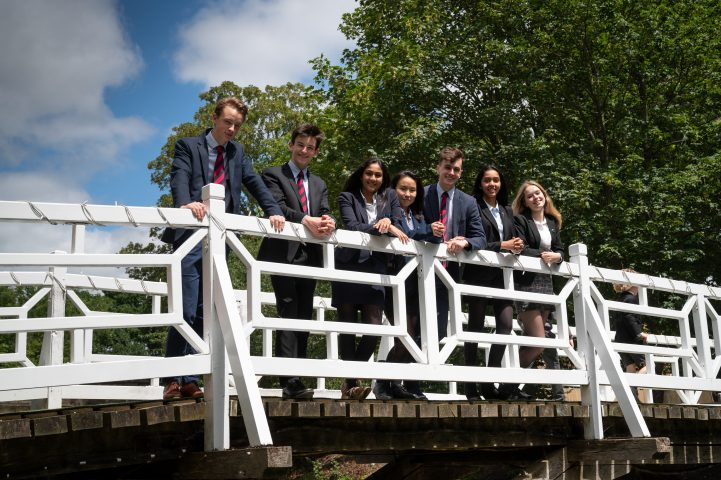 Magdalen College School Sixth Form pupils on white bridge
