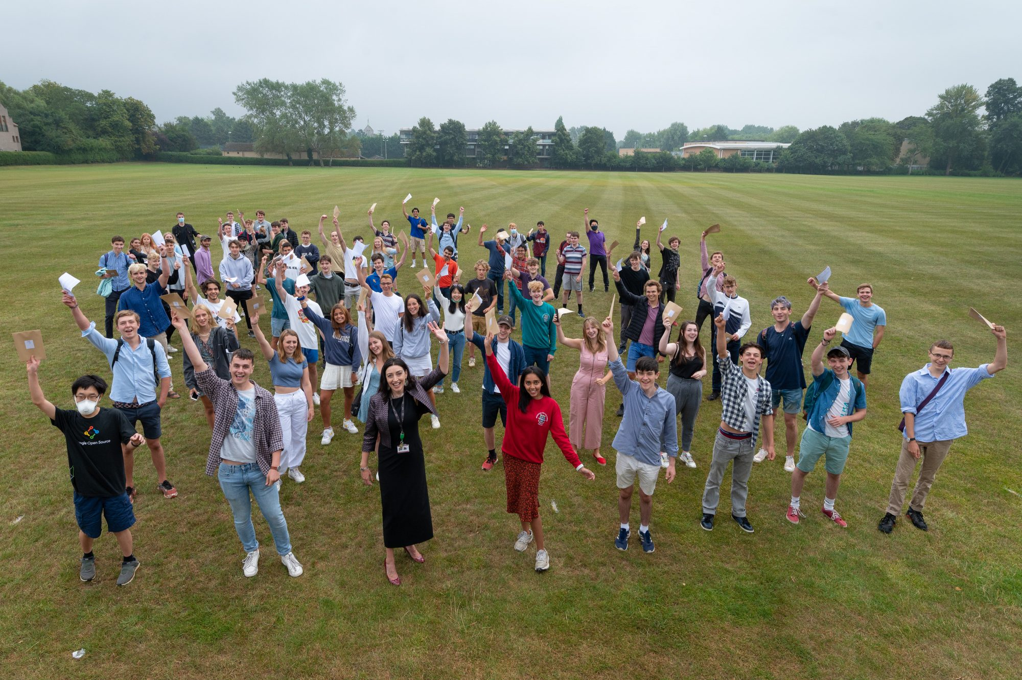 Magdalen College School pupils celebrating A-level results 2020 with the Master Helen Pike